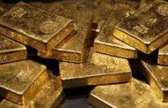 الذهب ينخفض بفعل توقعات بارتفاع أسعار الفائدة الأمريكية
